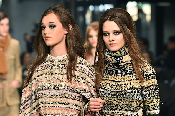 "Models present creations during the 12th Chanel Metiers dArt show ""Paris-Rome"", an annual event to honor craftsmanship that artisan partners bring to the houses collections, on December 1, 2015 at the Cinecitta studios in Rome.  AFP PHOTO / GABRIEL BOUYS / AFP / GABRIEL BOUYS        (Photo credit should read GABRIEL BOUYS/AFP/Getty Images)"