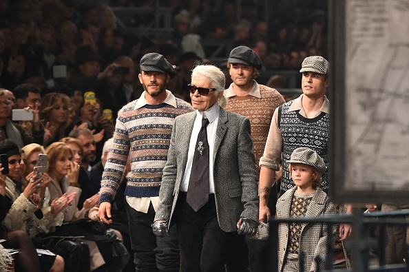 "German designer Karl Lagerfeld walks the runway with models at the end of the 12th Chanel Metiers dArt show ""Paris-Rome"", an annual event to honor craftsmanship that artisan partners bring to the houses collections, on December 1, 2015 at the Cinecitta studios in Rome.  AFP PHOTO / GABRIEL BOUYS / AFP / GABRIEL BOUYS        (Photo credit should read GABRIEL BOUYS/AFP/Getty Images)"