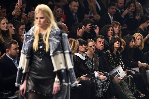 "US actress Kristen Stewart(C), US actress Geraldine Chaplin, Italian director Matteo Garonne and French actress Ludivine Sagnier (R) attend the 12th Chanel Metiers dArt show ""Paris-Rome"", an annual event to honor craftsmanship that artisan partners bring to the houses collections, on December 1, 2015 at the Cinecitta studios in Rome.  AFP PHOTO / GABRIEL BOUYS / AFP / GABRIEL BOUYS        (Photo credit should read GABRIEL BOUYS/AFP/Getty Images)"